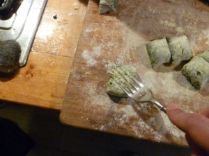 Marking grooves in the gnocchi to hold a sauce